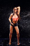 Sexy model in water splash Royalty Free Stock Images