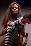 Sexy model wearing striped stockings (heels in focus) Stock Images