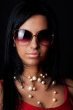 Sexy model wearing sunglasses Royalty Free Stock Photography