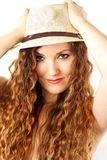 model woman in hat with curly long hair Royalty Free Stock Image