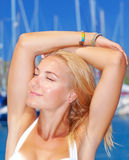Sexy model in yacht harbor Royalty Free Stock Photo