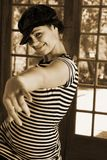 modern dancer in Black hat and striped top Stock Photo
