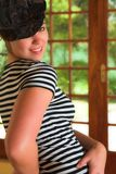 Sexy modern dancer in Black hat and striped top Royalty Free Stock Photography