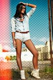 Sexy modern model in casual cloth jeans shorts outdoors Royalty Free Stock Images