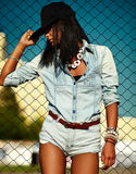 Sexy modern model in casual cloth jeans shorts outdoors Royalty Free Stock Photo