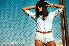 Sexy modern model in casual cloth jeans shorts outdoors Royalty Free Stock Photos