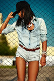 Sexy modern model in casual cloth jeans shorts outdoors Stock Photo
