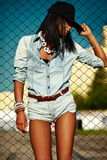Sexy modern model woman in casual jeans cloth Stock Image