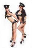 Sexy mooie donkerbruine semi naakte politie twee wome Stock Afbeeldingen