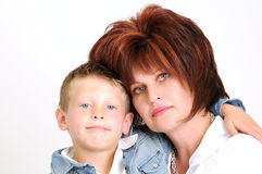 Sexy mother and teen son hugging and smiling Stock Photos