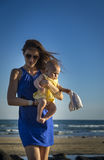 Sexy mother walks with baby Royalty Free Stock Photography
