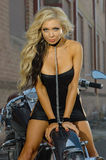 Sexy motorcycle biker girl Stock Images
