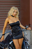 Sexy motorcycle biker girl Stock Image