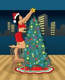 Sexy Mrs. Claus and christmas tree Stock Images
