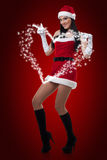 Sexy Mrs. Santa. A sexy young woman dressed in a santa outfit Stock Photos
