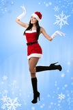 Sexy Mrs. Santa. A sexy young woman dressed in a santa outfit Stock Photo