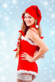 Sexy mrs. Santa. Smiling and posing on blue winter backround with snowflakes Royalty Free Stock Photography