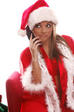 Sexy Mrs Santa Cellphone. A very sexy Mrs. Santa Claus talking to the Elves on her brand new cellphone Stock Photography