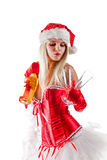 Sexy Mrs. Santa with champagne. Bottle and glasses, isolated on white background Royalty Free Stock Image