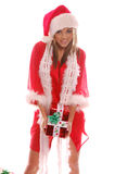 Mrs Santa Claus. A very Mrs. Santa Claus with a Christmas present stock photo