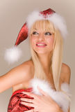 Sexy mrs. Santa Claus. In red hat Stock Photos