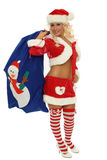 Sexy mrs santa clause. A very sexy mrs. santa clause standing by the Jolly old Elf a bag of gifts Stock Photography