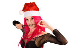 Sexy mrs. Santa with knife Royalty Free Stock Images