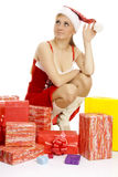 Sexy Mrs. Santa with a number of gift boxes. Royalty Free Stock Photography