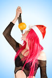 mrs. Santa with orange on the knife Royalty Free Stock Image