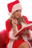 Mrs Santa;s List. A very Mrs. Santa Clause making a list are you on it stock images