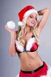 Sexy Mrs Santa With Snowball Royalty Free Stock Images