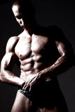 Sexy muscular body builder Stock Photos