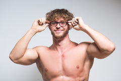 Sexy muscular male model wearing in glasses. Sexy portrait of a very muscular male model in glasses Royalty Free Stock Image