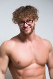 Sexy muscular male model wearing in glasses Stock Image