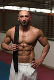 Sexy Muscular Man With Black Belt On Shoulder Royalty Free Stock Photo