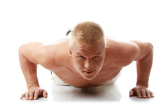 Sexy muscular man exercising Royalty Free Stock Images