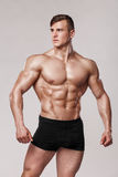 Sexy muscular man fitness model in underwear. Strong male naked torso abs Royalty Free Stock Photos