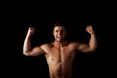 Sexy muscular man making fists. Royalty Free Stock Image