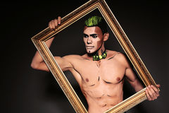 Sexy muscular man with painted face for Halloween party Stock Photography
