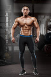 muscular man posing in gym, shaped abdominal. Strong male naked torso abs, working out stock photography