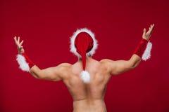 Sexy muscular man in santa uniform. Christmas New Stock Photos