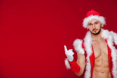 Sexy muscular man in santa uniform. Christmas New Stock Images