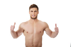 Sexy muscular man showing thumbs up. Royalty Free Stock Images