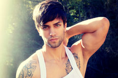 Sexy muscular man. In white tank top Royalty Free Stock Images