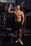 Sexy, Muscular Young Man Standing In Shorts Against Gym, Full Body Figure Stock Photo