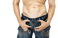 Sexy Muskular man stomach. Dark blue jeans Stock Photos