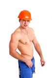 Sexy nackter Mechaniker, der auf einem weißen Hintergrund aufwirft Stockfotografie