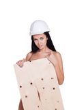 Sexy naked girl in a helmet with plywood. Royalty Free Stock Photo