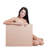 Sexy naked girl in a helmet with plywood. Stock Photography