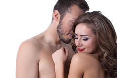 Sexy naked girl shyly hiding in arms of lover Stock Image